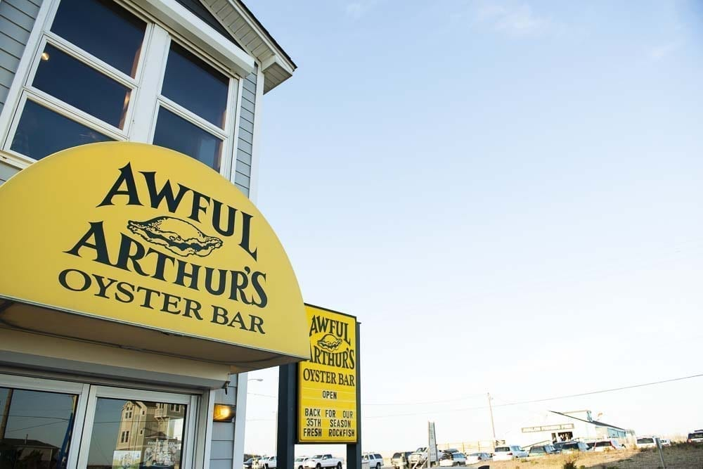 awful arthur's exterior with awning and sign