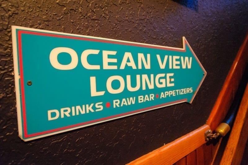 """awful arthur's sign """"ocean view lounge"""" drinks, raw bar, and appetizers"""